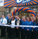 Staff pose outside B&M's latest store at the opening ceremony in Bicester.