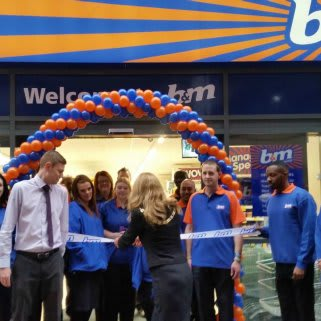 The Mayor of Bromley, Councillor Kim Botting, cutting the ribbon on the new Orpington store.