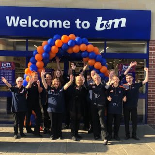 The store team at B&M's newest store in Rothwell pose in front of their wonderful new B&M Store, located on Commercial Street.