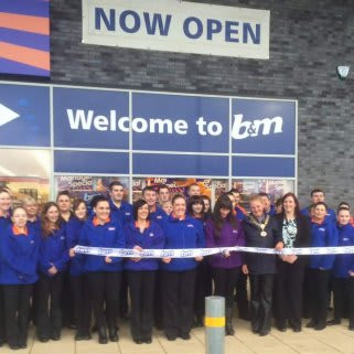 The store being opened by Lord Provost Anne Hall & representatives from Erskine Proud to Care Charity who gratefully accepted £250 of B&M vouchers.