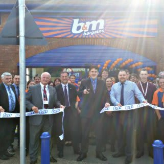 The ribbon being cut at B&M Braintree on opening day, with help from Councillor Tom Cunningham.
