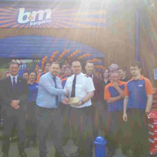 Robert Davies gratefully receiving £250 worth of B&M vouchers on behalf of the Salvation Army at B&M Braintree.