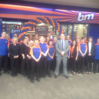 The B&M Kirkby team pose in front of their new and refurbished store at St Chads Parade (former Co-op)