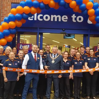 Mayor of Redcar & Cleveland, Billy Wells cuts the ribbon to officially open B&M's Redcar store.