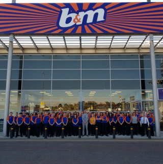 B&M Crescent Link, Londonderry's store team pose outside their brand new Bargains Store in the city.