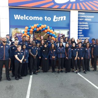The store team at B&M's newest store in Ilford pose in front of their wonderful new B&M Store, located on Horns Road.