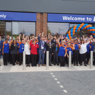 B&M Clifton's store team celebrate the opening of their brand new store on Green Lane.