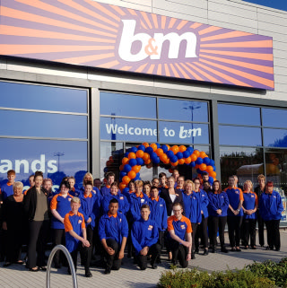Staff at B&M's latest store in Telford celebrate opening their doors to their very first customers.