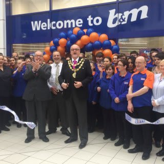 Councillor Mike Connolly was B&M's special guest at the Bury relocation and reopening, cutting the ribbon to officially open the Mill Gate Shopping Centre store.