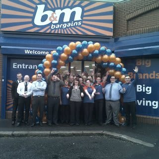 Staff outside the new B&M Bargains on Cregagh Road, Belfast celebrate its opening on Friday