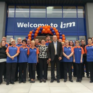 The store team pose in front of their recently refurbished B&M store in Belper.