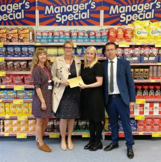 Store staff at B&M's newly re-fitted store in Blackpool (Vicarage Lane) present their nominated local charity with £250 worth of B&M vouchers.
