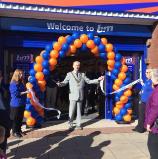 "Mayor Denton Jones opened B&M's newest Bargains Store in Normanton, along with local charity ""The Well Project"" group. Michelle Newton accepted £250 worth of B&M vouchers on behalf of the charity, as a thank you for opening the store."