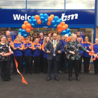 Local Mayor, Councillor Shadab Qumer cuts the ribbon to officially announce B&M's relocated Chadderton store 'open'.