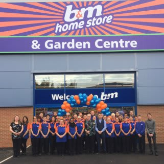 B&M Chadderton's store team pose outside their brand new store at Gateway Retail Park.