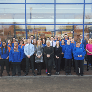 Store staff pose outside their new B&M Homestore at the Castle Retail Park, Nottingham
