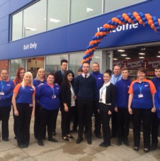 Staff pose outside Bristol's brand new B&M Home Store, located on Centaurus Road, Cribbs Causeway.