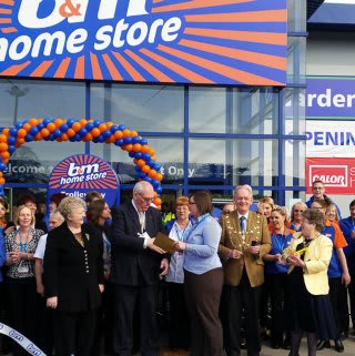 Dunstable store being opened by Councillor Terry Stock and Representatives from the local charity DADDS.