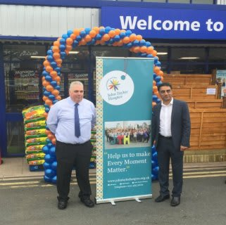 Representatives from John Taylor Hospice were B&M's special VIPs for the day, cutting the ribbon for the new store in Minworth