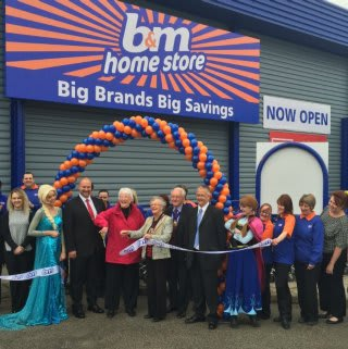 Store manager Andy Cowper-Johnson is joined by Councillor Alison Austin who cut the ribbon with B&M Local Hero Nora Sparling of Butterfly Hospice.