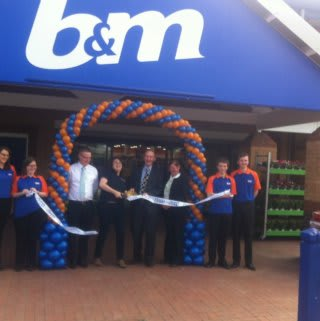 B&M Walsall Wood is officially opened by Paula Mitchell of Acorns Children's Hospice, who received £250 worth of B&M vouchers.
