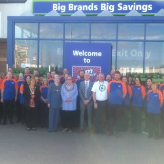Mayor of Barrow, Councillor Ann Thomson and representatives from Great North Air Ambulance pose with store manager, Mark Finan and store staff.