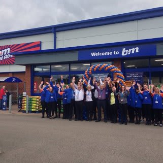 Staff celebrate the opening of the latest B&M store in Towcester