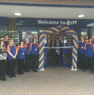 Chairman of East Riding of Yorkshire Council, Councillor Peter Turner cuts the ribbon and officially declares the new B&M Home Store in Willerby, open.