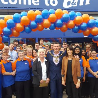 Store staff pose outside the brand new Burnage store, with Lord Mayor, Councillor Carl Austin-Behan.