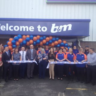 B&M Pembroke Dock being officially opened by the Mayor of Pembroke, Councillor Maureen Colgan, and Liz, a representative of Pennar Community Hall.