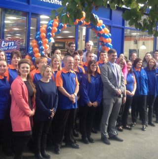 The B&M store team in Gravesend pose in front of their brand new Home Store on New Road.