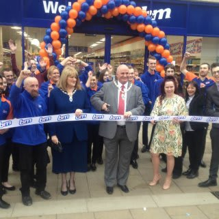 The Deputy Mayor of Peterborough, Councillor Keith Sharp, cutting the ribbon to officially open B&M Peterborough