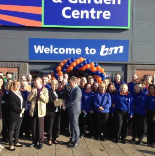 Representatives from Hartlepool Families First gratefully accepting £250 worth of B&M vouchers as a thank you for opening B&M Teesbay
