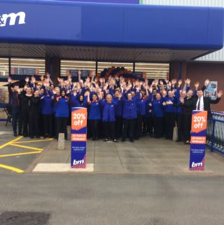 Store staff pose outside their new B&M Burton-upon-Trent store on Horninglow Road.