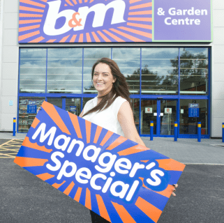 Store manager Kelly Mather poses in front of B&M's brand new Bargains Store & Garden Centre in Brighouse.