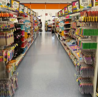 A glimpse down the Back to School aisle of B&M's new store in Baglan Bay, Port Talbot.