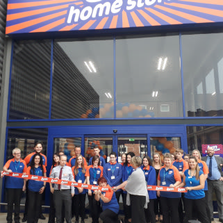 B&M's store team cut the ribbon on opening day, welcoming their first customers on Westlode Street, Spalding.