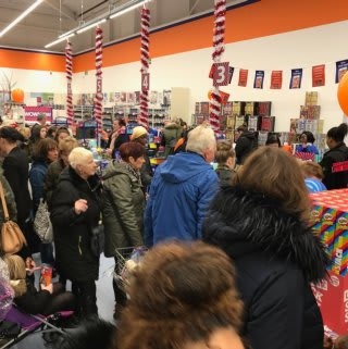 Shoppers queue to pay for their items at B&M's newest store in Dagenham (Merrielands Retail Park).