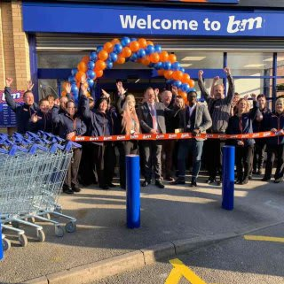 B&M store staff at Kirkby-in-Ashfield show their excitement at the official opening of their brand new store in the town.
