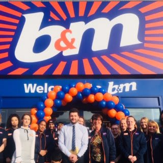The store team at B&M's newest store in Huddersfield pose in front of their wonderful new B&M Store, located on Leeds Road Retail Park.