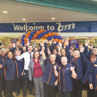 The store team at B&M's newest store in Heywood pose in front of their wonderful new Home Store, located at Times Retail Park..