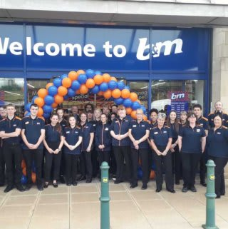 The store team at B&M's newest store in Kirkstall pose in front of their wonderful new B&M Store, located on Savins Mill Way