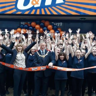 Store staff at B&M's newest store in Dover celebrate as local mayor, Councillor Gordon Cowan cuts the ribbon to officially open the store.