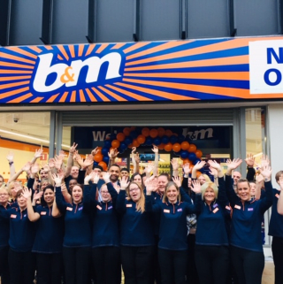 The store team at B&M's newest store in Wolverhampton pose in front of their wonderful new B&M Store, located in the city centre at the Mander Centre.