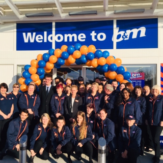 The store team at B&M's newest store in Portsmouth pose in front of their wonderful new B&M Store, located at Ocean Retail Park.