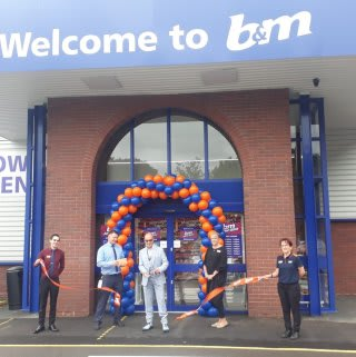 Local Hero Dale Preece-Kelly cuts the ribbon at B&M's new store in Kidderminster. Mr Preece-Kelly received £250 worth of B&M vouchers as a thank you for his hard work in the community.