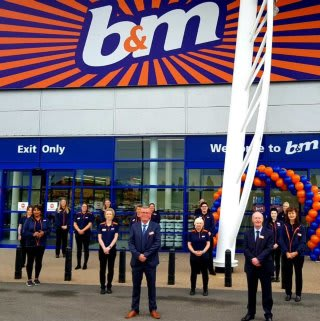 The store team at B&M's newest store in Lisburn pose in front of their wonderful new B&M Store, located at Sprucefield Retail Park.