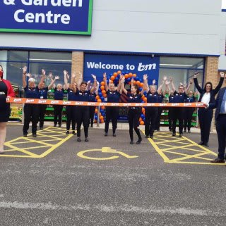 The store team at B&M's newest store in Doncaster pose in front of their wonderful new B&M Store & Garden Centre, located at Lakeside Village Outlet Shopping.
