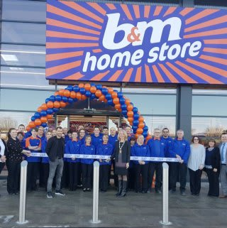 B&M Portlethen being officially opened by Aberdeen footballer Niall McGinn, and Deputy Provost Allison Grant.