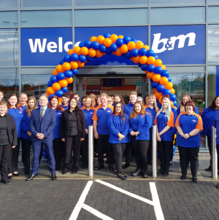 B&M Livingston's store team pose in front of the new B&M Home Store & Garden Centre, Almondvale Business Park.